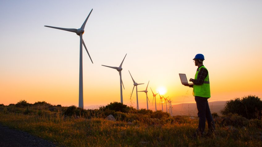 wind turbine technician at sunset