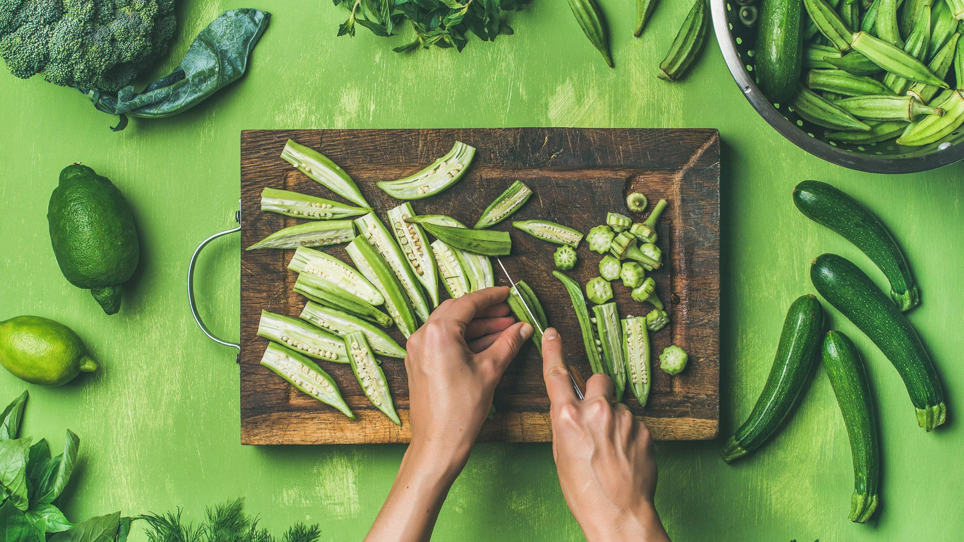 woman cutting healthy green vegetables