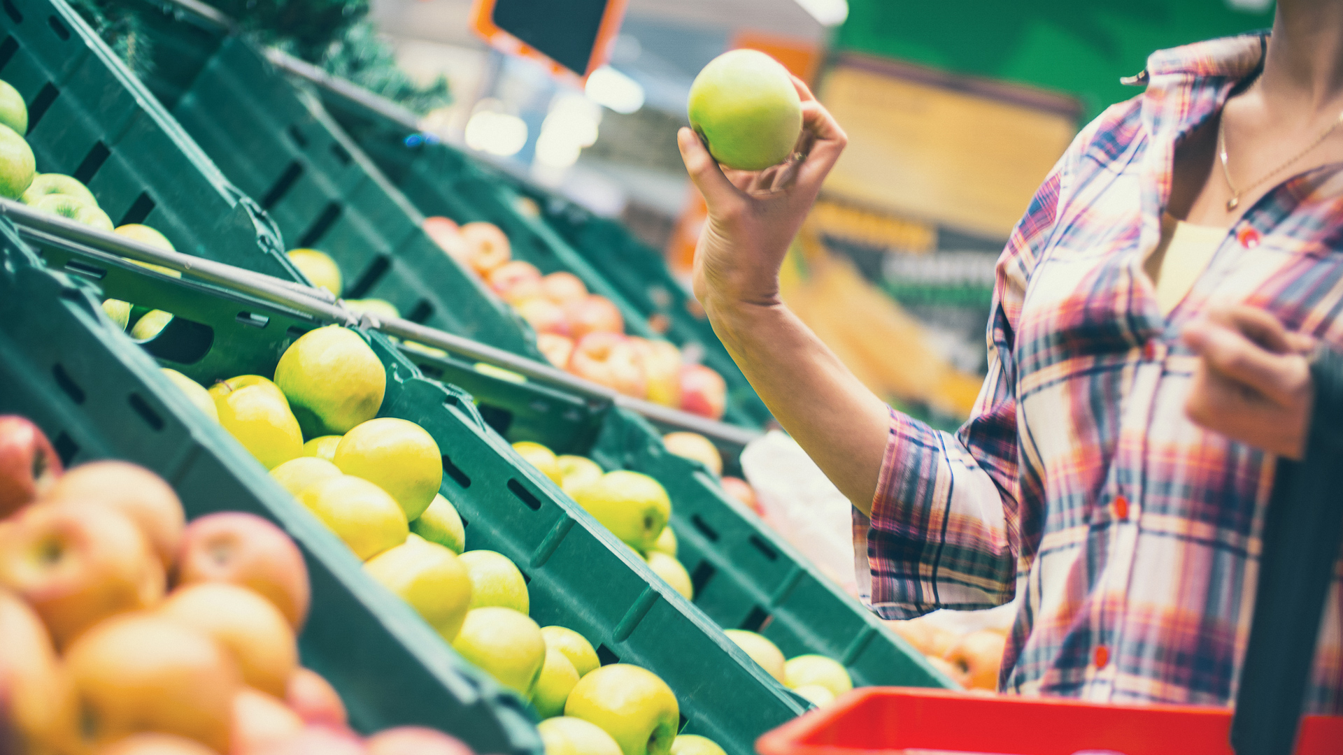 woman grocery shopping fresh produce