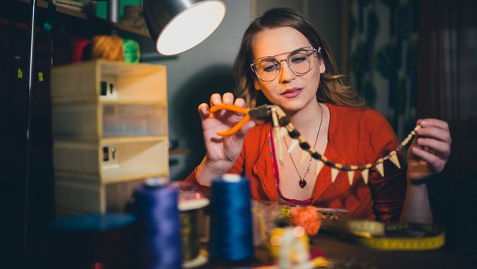 Woman making jewelry for hobbies at home.