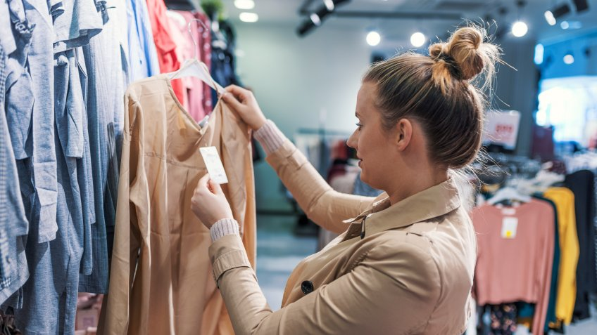 woman shopping for clothes deals