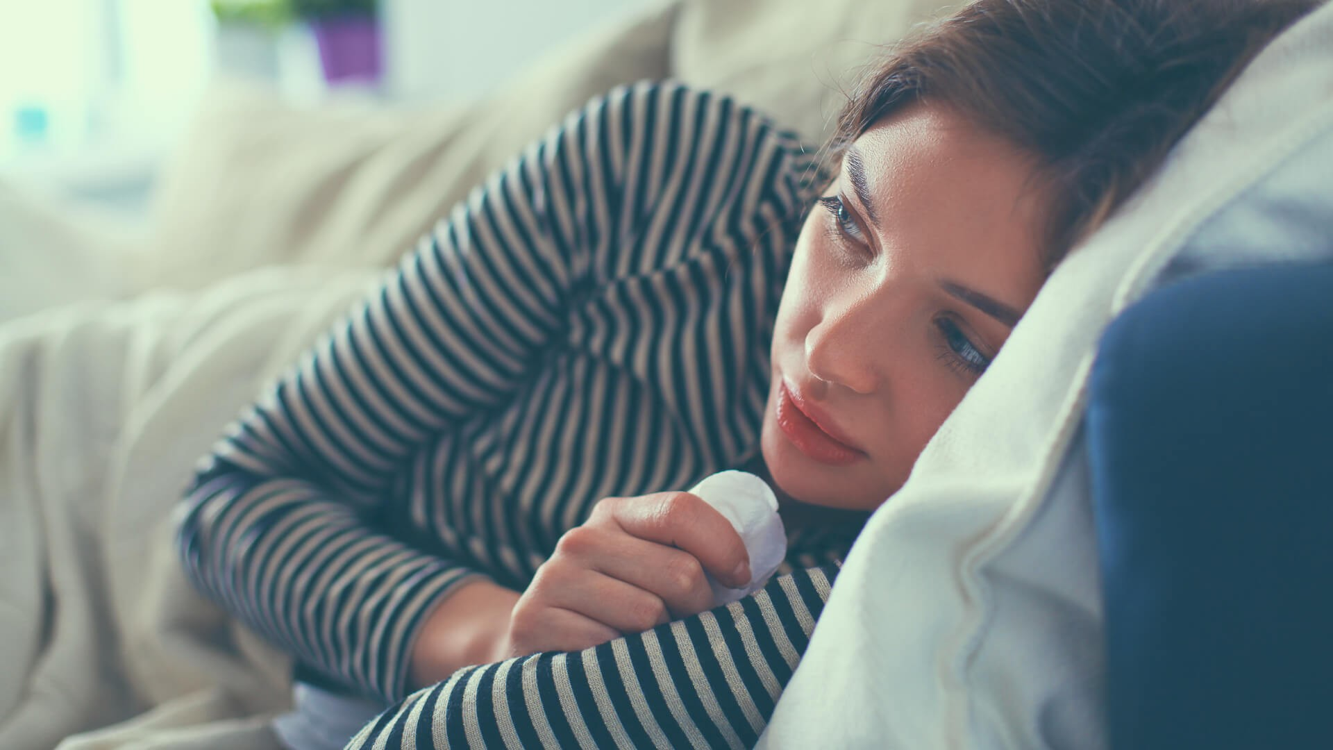 woman staying home sick from work