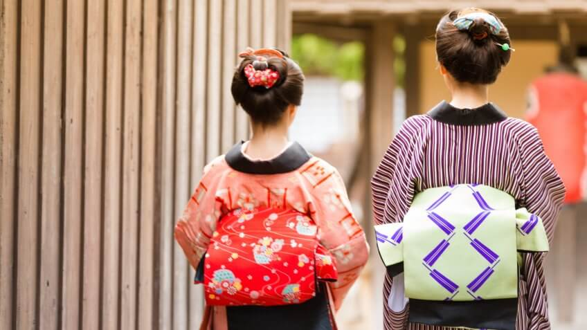 Mother and Daughter Exploring a Small Village Somewhere in Japan.