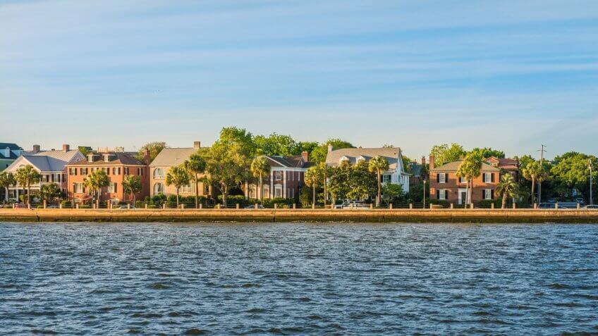 A view of waterfront homes in historic Charleston, South Carolina at sunset.