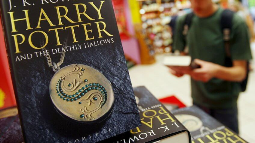 A Potter Fan Picks Up a Copy of J K Rowling's Final Harry Potter Book 'Harry Potter and the Deathly Hallows' at a Book Store in London