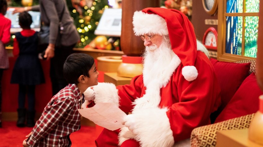Mall Santa greeting a child