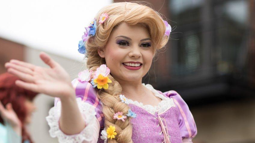 Holland, Michigan, USA - May 12, 2018 Members of Everafter West Michigan dress up as disney princess  at the Muziek Parade, during the Tulip Time Festival.