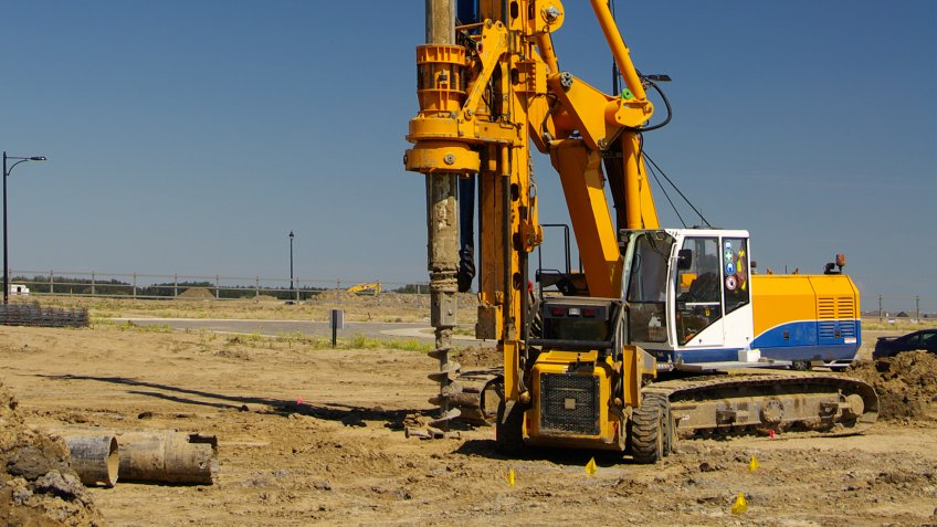 An industrial rotary drill used to create holes for footings and pilings.