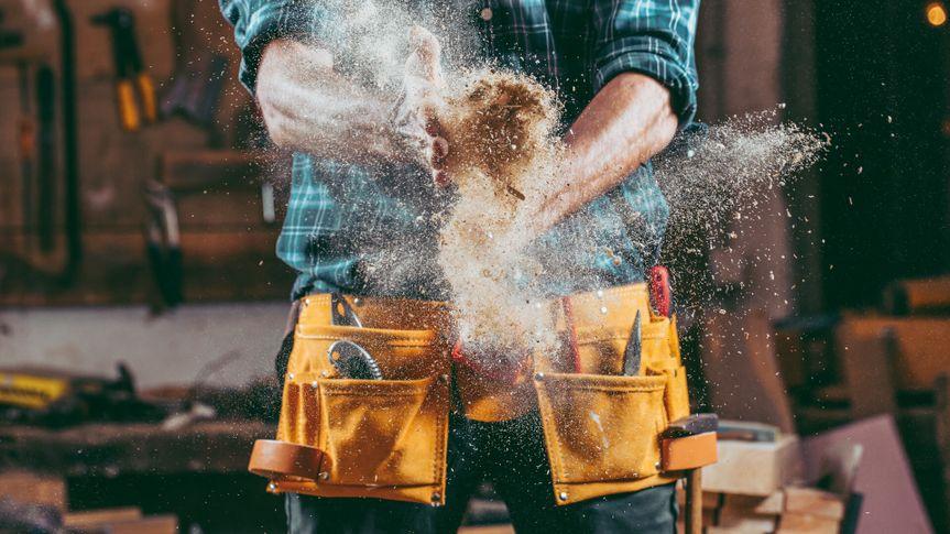 Young handosme carpenter.