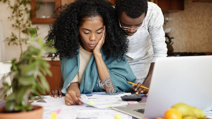couple frustrated doing their taxes