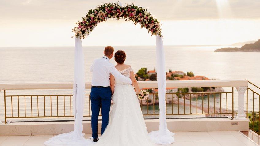 destination wedding couple at altar
