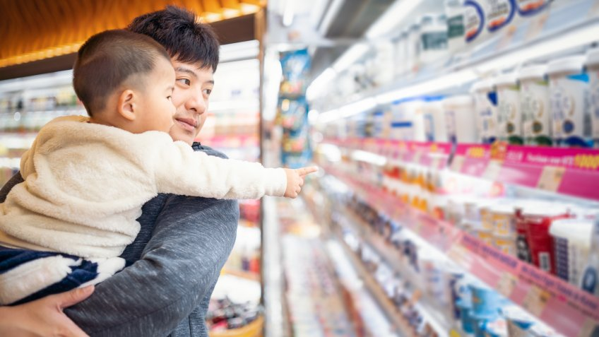 father and son shopping in a supermarket.