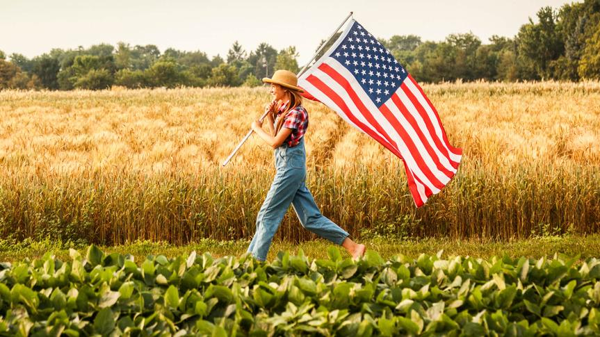 girl running through soybean farm field