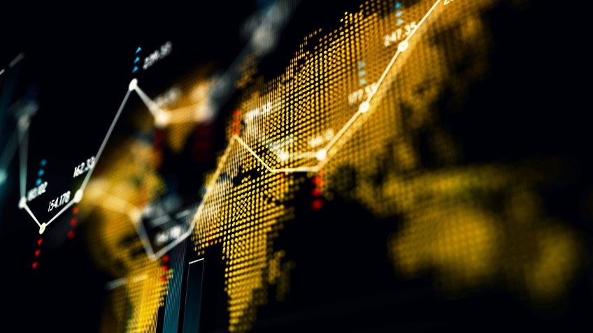 Financial data analysis graph over world map.