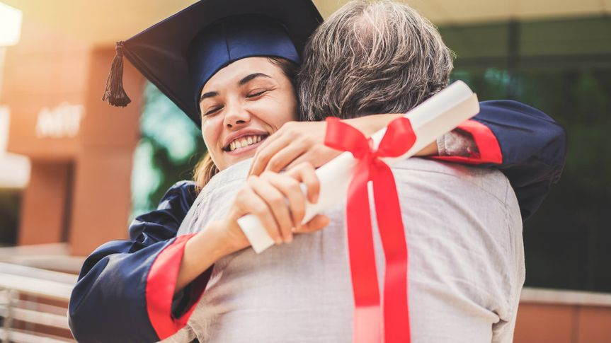 Graduated student hugging her father.