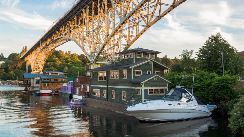 House boats on Lake Union in Seattle, WA with Aurora Bridge overhead.