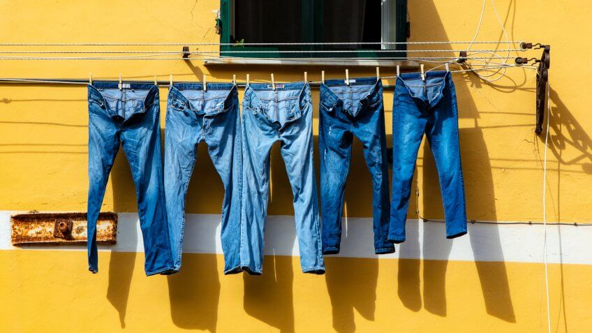 jeans hanging on a clothes dry line