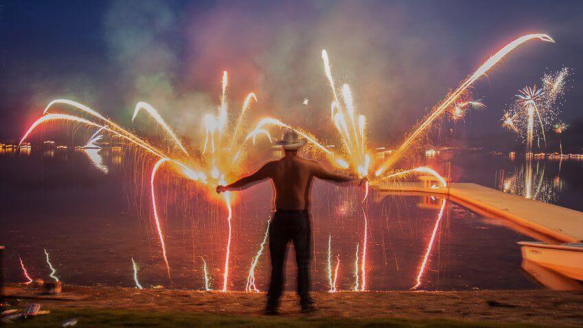 man holding Roman candle fireworks