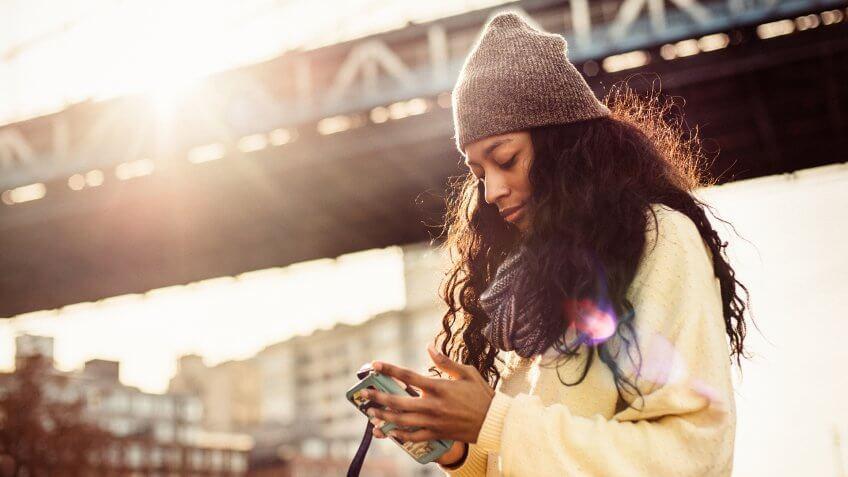 Hispanic woman using Smartphone in New York City.