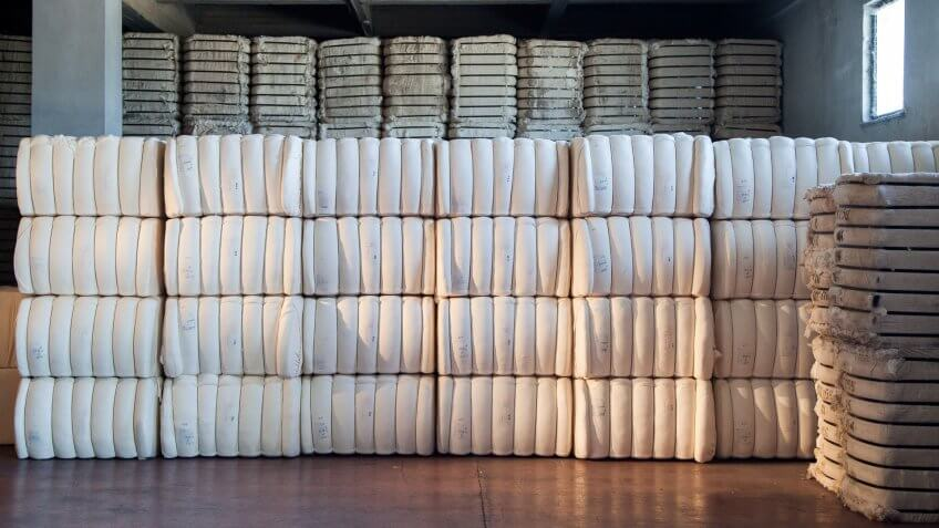 raw cotton bales in warehouse