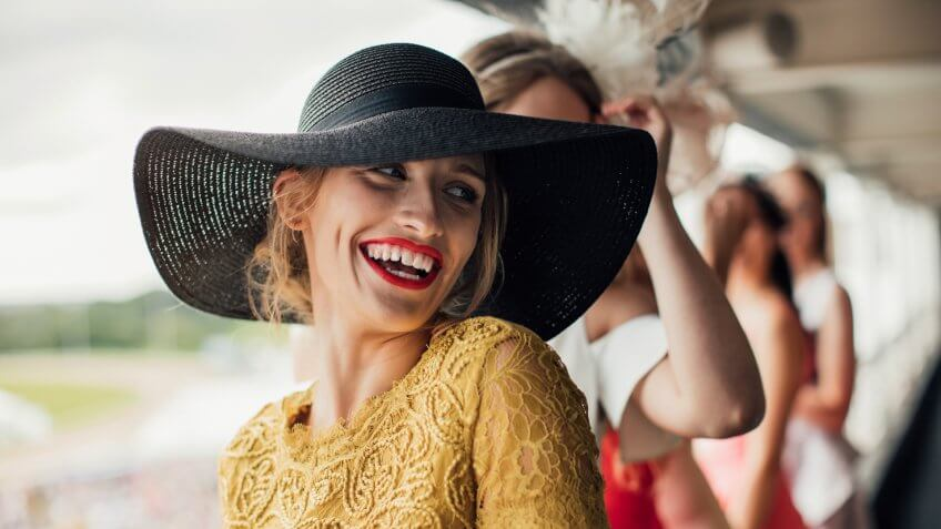 A young beautiful woman on ladies day, smiling and laughing at friends.