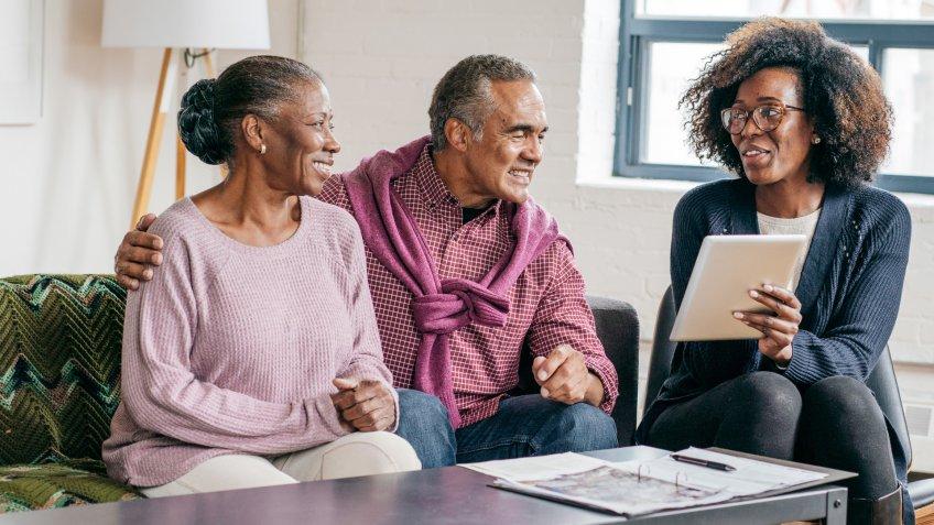 Home consultation for senior couple.
