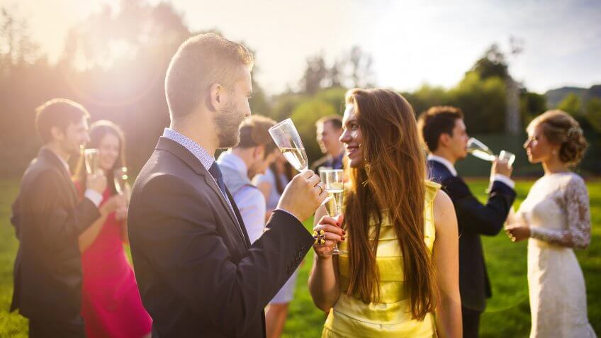 wedding guest couple drinking champagne