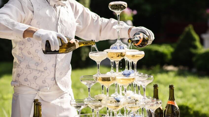 wedding server pouring champagne