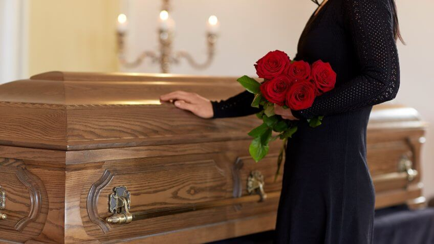woman grieving in funeral home