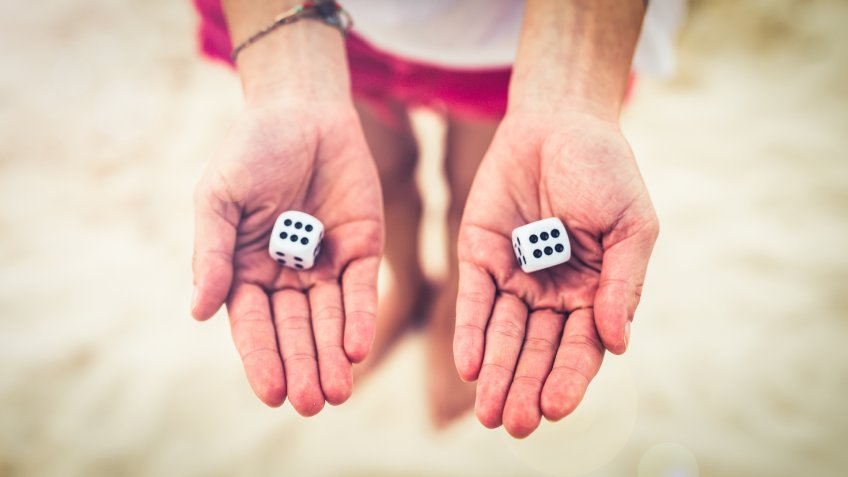 woman revealing doubled dice
