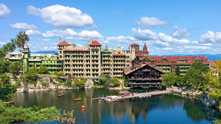 Mohonk Mountain House across a lake with a dock and small rock island in New Paltz, New York - Image.