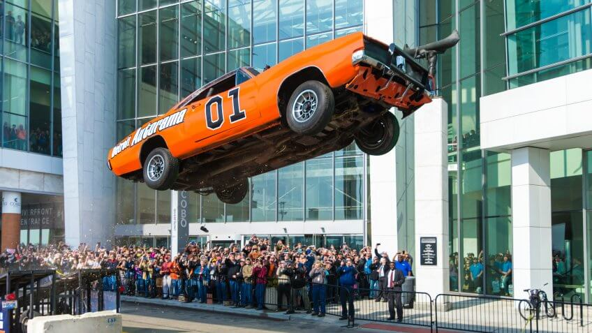 DETROIT, MI/USA - February 24, 2017: The General Lee car, a Dodge Charger from the Dukes of Hazzard TV show, airborne in a stunt jump, in front of Cobo Center, at the Detroit Autorama hot rod show.