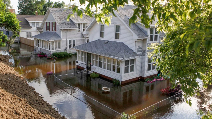 Mandatory Credit: Photo by Charles Rex Arbogast/AP/Shutterstock (6276267ad)Floodwaters from the Souris River surround homes on 3rd St.