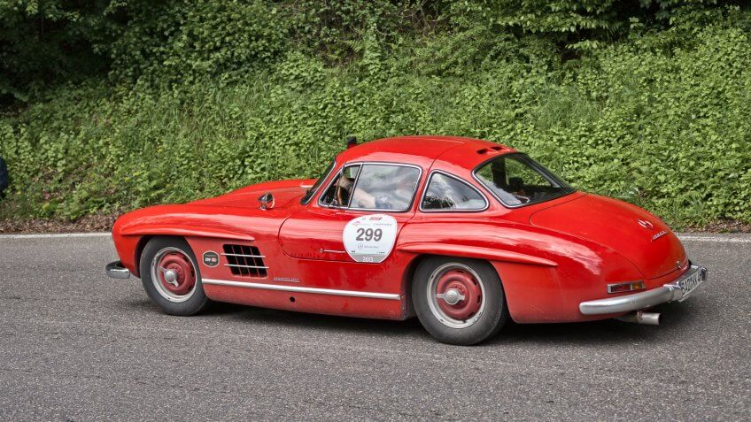 PASSO DELLA FUTA (FI), ITALY - MAY 18: driver and co-driver on old sports car Mercedes Benz 300 SL W 198 (1954) in historic Italian race Mille Miglia on May 18, 2013 in Passo della Futa (FI) Italy - Image.