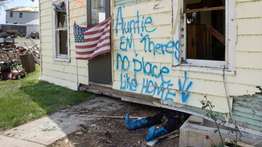 Mandatory Credit: Photo by Nati Harnik/AP/Shutterstock (6399042a)A stuffed pair of pants and blue boots are seen, under a house that was lifted off it's foundation by Saturday's tornado in Hallam, Neb.