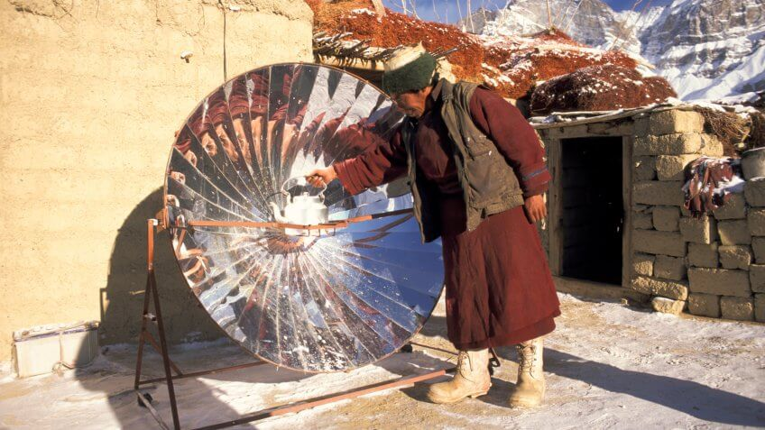 man with solar cooker, Zanskar, Ladakh, India