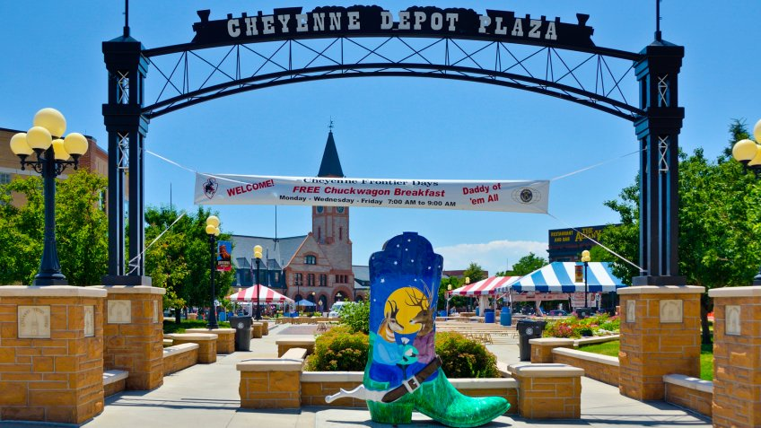 Cheyenne, Wyoming, USA - July 21, 2013: People near the entrance to the Cheyenne Depot Plaza, city park in downtown Cheyenne.