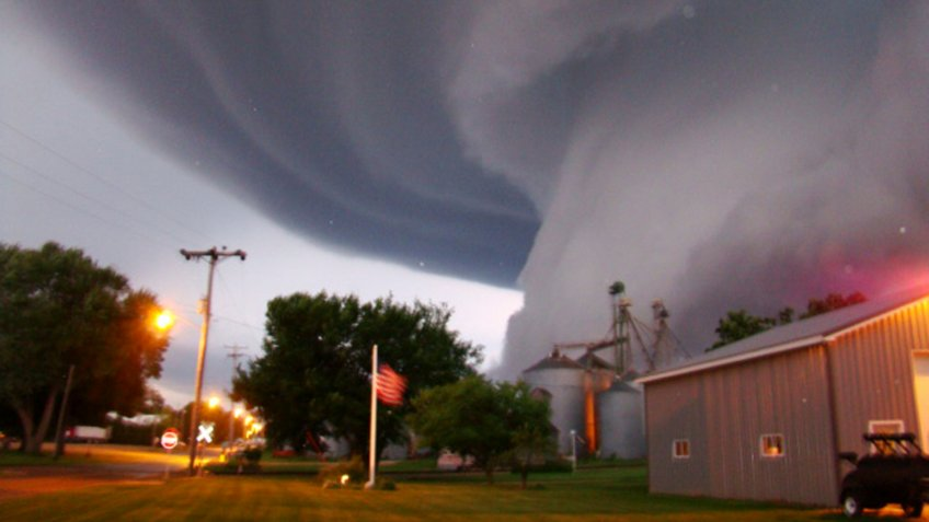 Mandatory Credit: Photo by Lori Mehmen/AP/Shutterstock (9614247a)A huge tornado funnel cloud touches down in Orchard, Iowa, at 9:04 p.