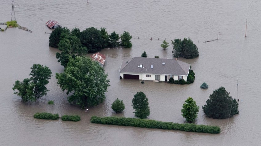Mandatory Credit: Photo by Nati Harnik/AP/Shutterstock (6275787a)A home is engulfed by flood water in Hamburg, Iowa from the rising Missouri River.