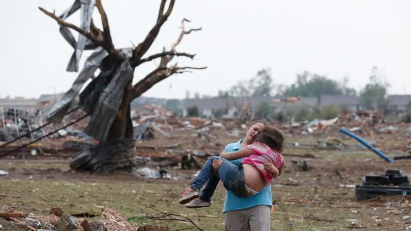 Mandatory Credit: Photo by Sue Ogrocki/AP/Shutterstock (6211799a)LaTisha Garcia carries her 8-year-old daughter, Jazmin Rodriguez near Plaza Towers Elementary School after a massive tornado carved its way through Moore, Okla.