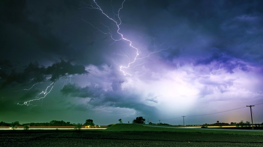 Tornado Alley Severe Storm at Night Time. Severe Lightnings Above Farmlands in Illinois, USA