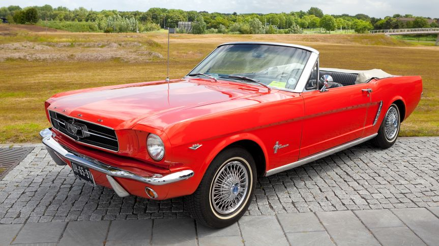 LELYSTAD, THE NETHERLANDS - JUNE 17: A 1965 Ford Mustang Convertible on display at the annual National Oldtimer day on June 17, 2012 in Lelystad, The Netherlands - Image.