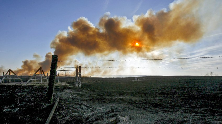 Mandatory Credit: Photo by Larry W Smith/EPA/Shutterstock (7878877e)A Wildfire Burns in the Distance Near Mclean Texas Tuesday 14 March 2006 Eleven Fires Tuesday Burned Across an Estimated Nearly 700 000 Acres of Land in the Texas PanhandleUsa Texas Wildfires - Mar 2006.