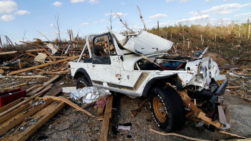 Mandatory Credit: Photo by Rogelio V Solis/AP/Shutterstock (6284601e)A Jeep shows the extent of Wednesday's tornado's force by its extensive damage in Phil Campbell, Ala.