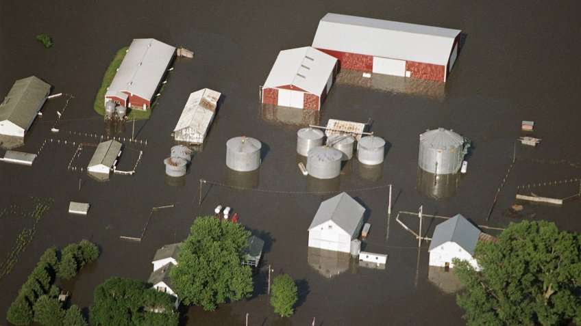 Mandatory Credit: Photo by Charlie Neibergall/AP/Shutterstock (6550637a)A rural Colfax, Iowa, farm is surrounded by flood waters, Central Iowa was hit by heavy flooding in Colfax, Iowa, on after weeks of heavy rain in the upper MidwestFloods U.