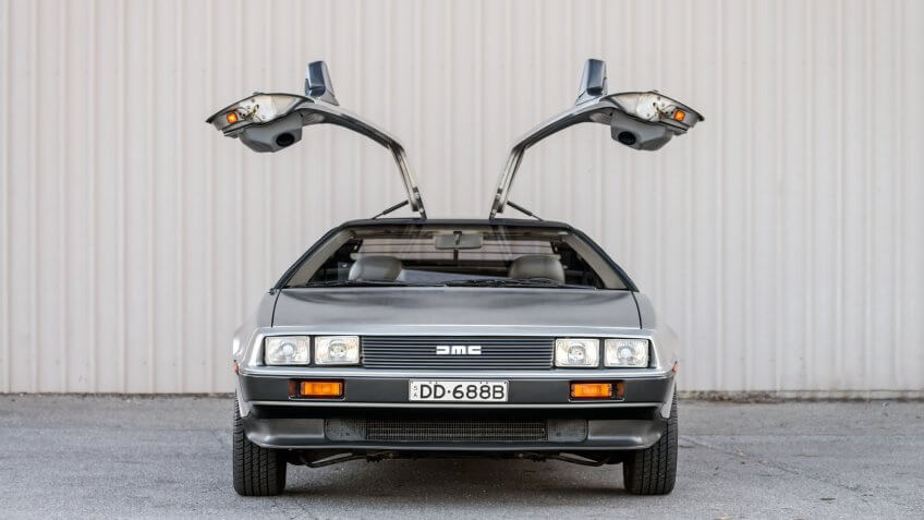 Adelaide, Australia - September 7, 2013: DeLorean DMC-12 car with opened doors parked on street near shed - Image.