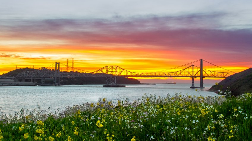 Sunset lights up the sky behind the Carquinez bridge in the Bay area of California.