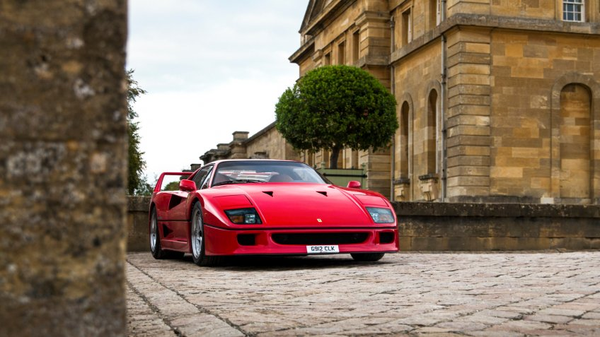 Oxford, England - September 2018: red Italian classic supercar Ferrari F40, made in 1987, parked outside Blenheim Palace, attending annual Salon Prive automotive event.