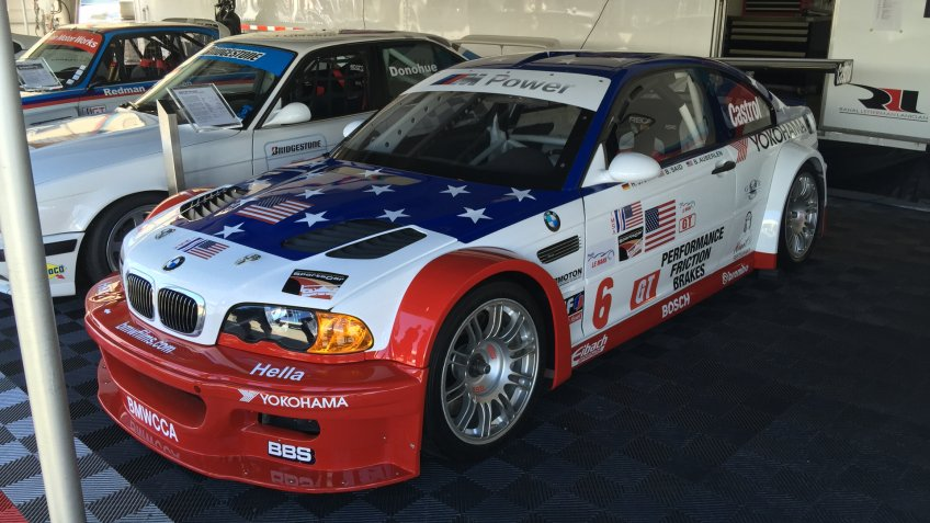 """Monterey, CA - August 14, 2015 - A 2001 BMW M3 GTR as seen at Mazda Raceway Laguna Seca featuring a """"Stars and Stripes"""" livery as a 9/11 tribute."""