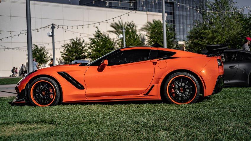 Fiery Orange Chevrolet Corvette ZR1 Parked on a grass field in Las Vegas, Nevada / USA - June 26th, 2019 - Image.